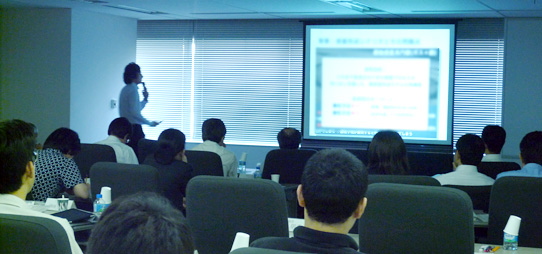 photo: Super-postdoctoral JSPS research fellow give a presentation to the Center's researchers.