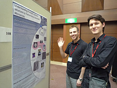 Mr. Granier (right) in poster presentation session